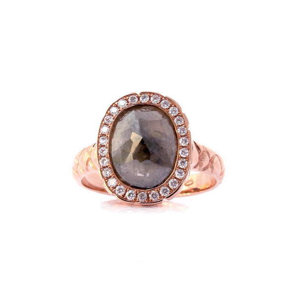 Crafted in 14KT rose gold, this ring features a diamond halo with an oval rose-cut diamond centre and a quilted band.