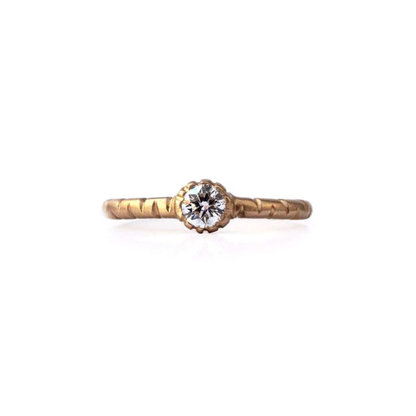 Crafted in 14KT brushed yellow gold, this ring features a round brilliant-cut diamond and a semi-quilted band.