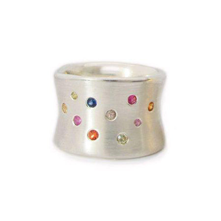 Crafted in brushed sterling silver, this smooth, organically shaped 14mm wide band is studded with an array of unique multi-coloured sapphires.