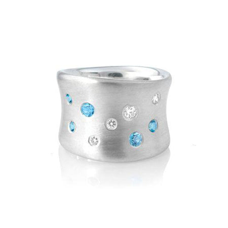 Crafted in brushed sterling silver, this smooth, organically shaped band is studded with both diamonds and blue topaz.