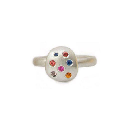 Crafted in brushed sterling silver, this smooth, organically shaped ring features an oval studded with an array of unique multi-coloured sapphires.