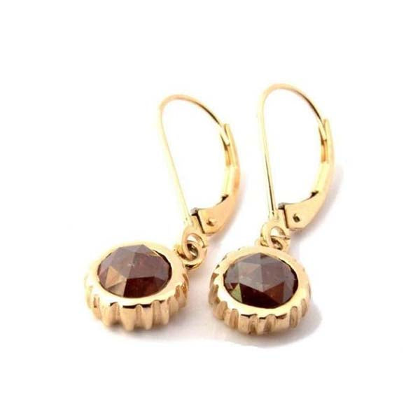 Crafted in 14KT yellow gold, these drop earrings feature oxblood red round rose-cut diamonds in cupcake settings.
