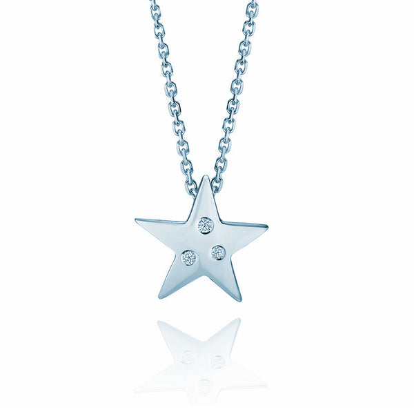 Crafted in 14KT white gold, this star shaped pendant is set with 3 round brilliant-cut diamonds.