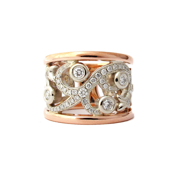 Crafted in 14KT white and rose gold, this ring features a diamond-set vine design with fleur de lys.