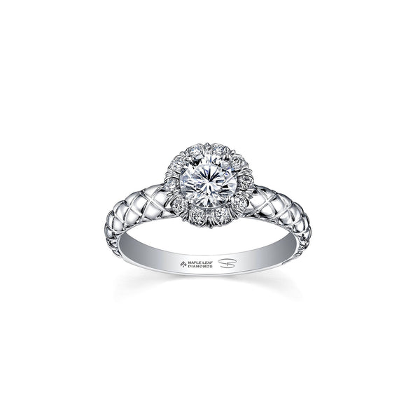 Crafted in 18kt Pure White™, this engagement ring features a melee diamond fur-trim halo with a round brilliant-cut Canadian centre diamond on a quilted band.
