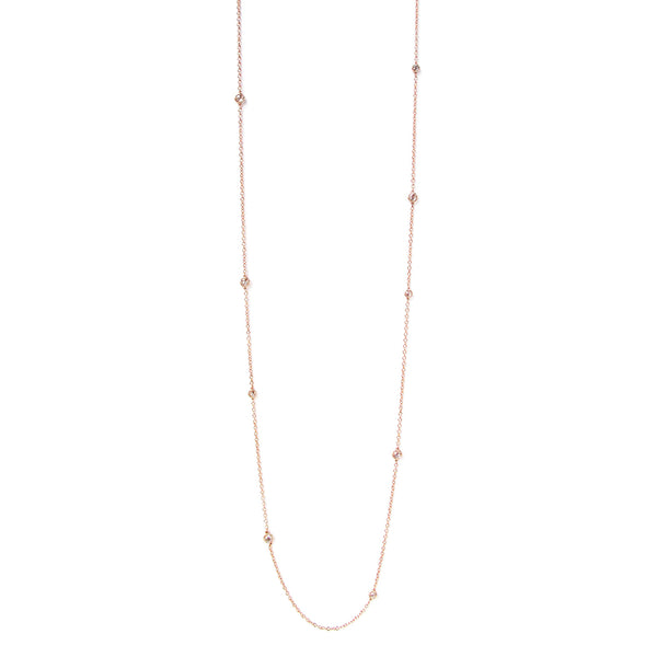 Crafted in 14KT yellow gold, this necklace features small white rose-cut diamonds all along the chain.