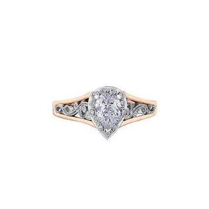 Crafted in 18KT white and rose Certified Canadian Gold, this engagement ring features a diamond halo with a pear-shaped Canadian centre diamond on a diamond set band with a rose vine design.