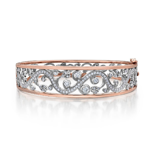 Crafted in 14KT white and rose Certified Canadian Gold, this bangle bracelet features a rose vine design set with round brilliant-cut Canadian diamonds.