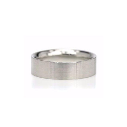 Crafted in 14KT white gold, this 6.5mm wide flat men's ring offers a curved comfortable fit.