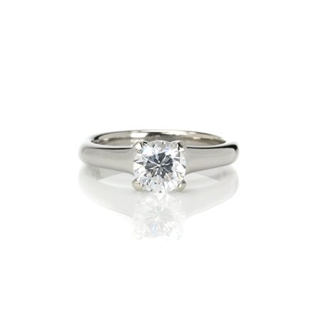 Crafted in 14KT white gold, this ring features a round-cut diamond in the classic four-prong setting.