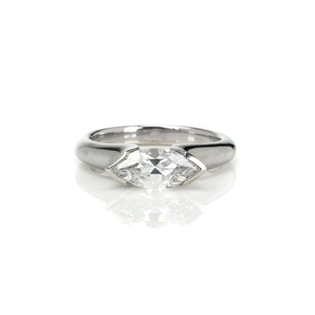 Crafted in 14KT white gold, this ring features a half-bezel set marquise-cut diamond horizontally on the band.