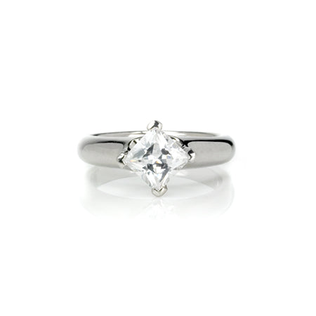 Crafted in 14KT white gold, this ring features a princess-cut diamond in a diagonal prong setting.