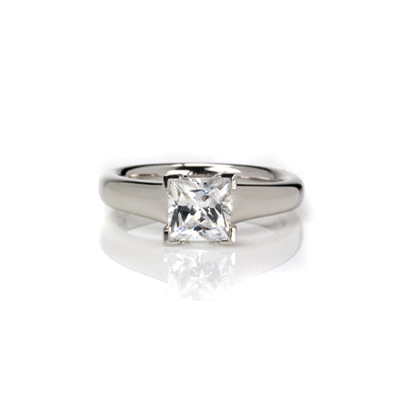 Crafted in 14KT white gold, this ring features a princess-cut diamond with v-shaped prongs holding it in place.