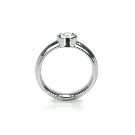 Crafted in 14KT white gold, this ring features a bezel set round brilliant-cut diamond.