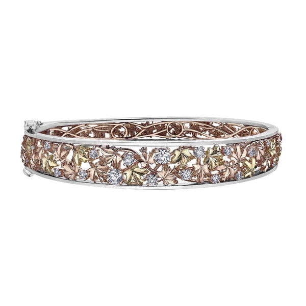 Nature inspired bangle features leaves crafted from 14KT Canadian Certified Gold. This bracelet is sprinkled with one carat of Canadian diamonds.
