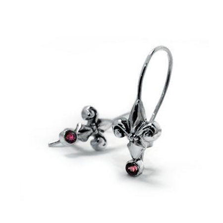 Crafted in oxidized sterling silver, these drop earrings each feature a Fleur de Lis set with a round-cut red garnet.