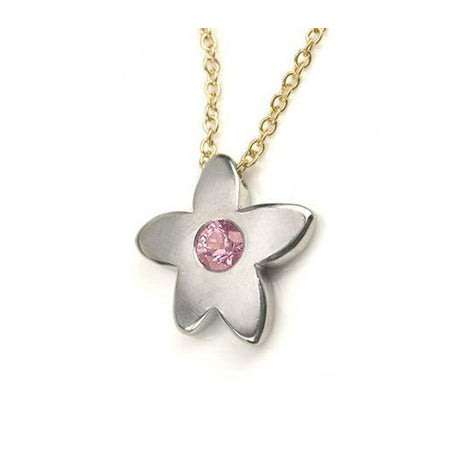 Crafted in 14KT white gold, this necklace features a flower pendant with a pink sapphire centre.