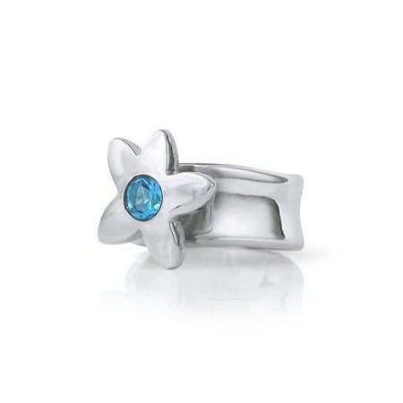 Crafted in sterling silver, this ring features a large flower with a blue topaz centre.