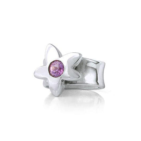 Crafted in sterling silver, this ring features a large flower with an amethyst centre.