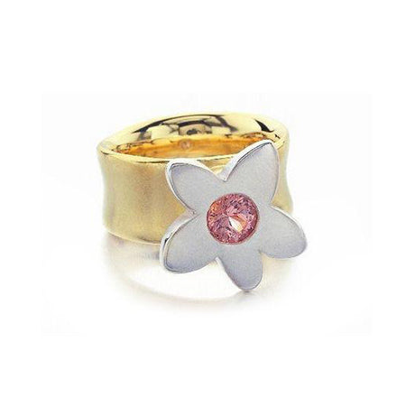 Crafted in 14KT yellow and white gold, this ring features a large flower with a pink sapphire centre.