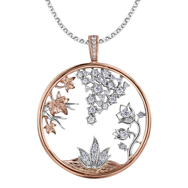 Crafted in 14KT Certified Canadian gold, this pendant represents Canada's four seasons. Featuring a round-cut diamond, fall leaves, spring flower buds, winter's snowflakes and summer roses.