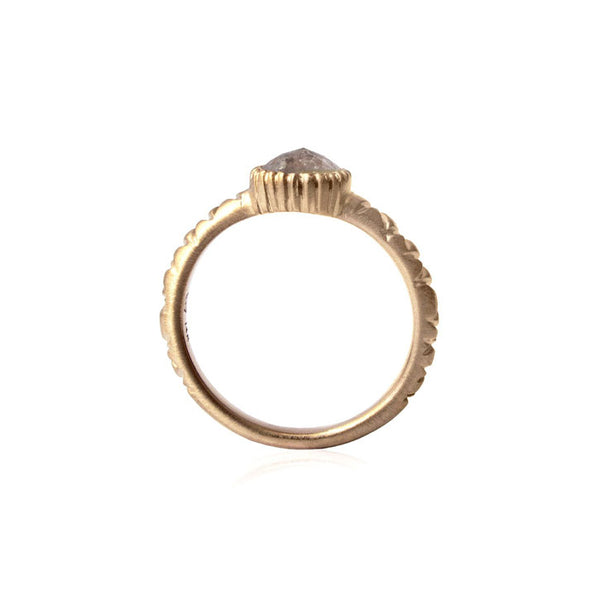 Crafted in 14KT yellow gold, this ring features a grey rose-cut diamond in a cupcake bezel setting and a quilted band.