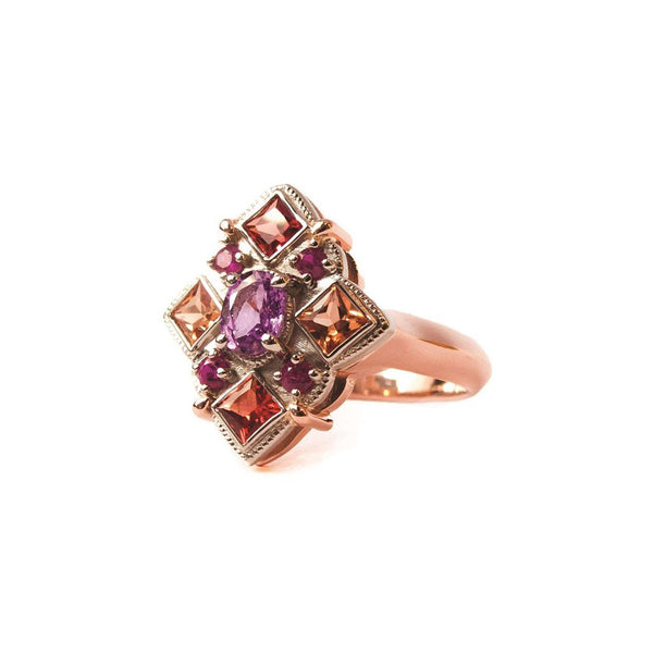 Crafted in 14KT rose and yellow gold, this ring features round, oval and square colourful sapphires set in a diamond shape.