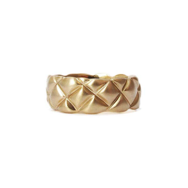 7mm quilted band crafted in 14KT yellow gold.