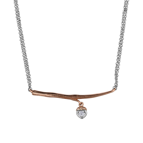 Crafted in 14KT rose Canadian Certified Gold, this necklace features a branch with an acorn charm set with a round brilliant-cut Canadian diamond.
