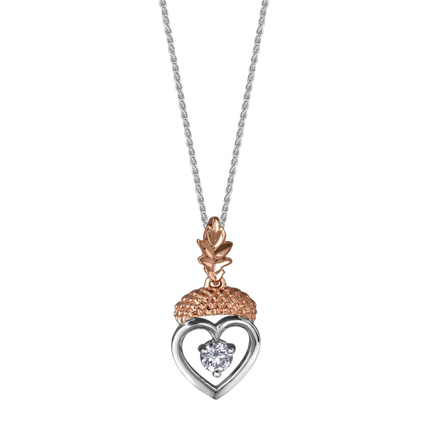 Crafted in 14KT rose and white Canadian Certified Gold, this necklace features a heart-shaped acorn pendant with a round brilliant-cut Canadian centre diamond and an oak leaf bail.