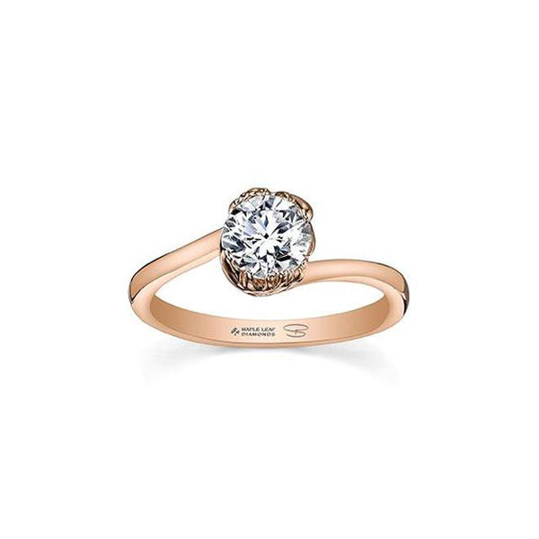 Ring features a maple leaf fashioned from 18KT rose Canadian Certified Gold cradling a 0.70 CT round brilliant-cut Canadian diamond.