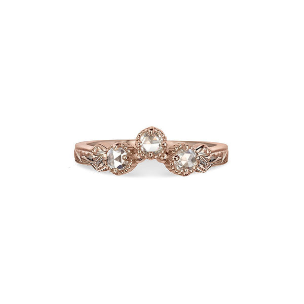 Crafted in 14KT rose gold, this ring has a curve featuring 3 rose-cut diamonds in a row on a vintage-inspired hand engraved band.