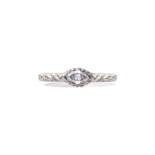 Crafted in 14KT brushed white gold, this ring features a bezel-set marquise-cut diamond on a quilted band.