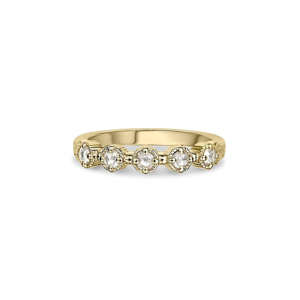 Crafted in 14KT yellow gold, this ring features five rose-cut diamonds in cupcake settings on a vintage-inspired hand engraved band.