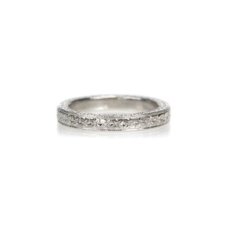 Crafted in 14KT white gold, this band is hand-engraved with an orange blossom design.