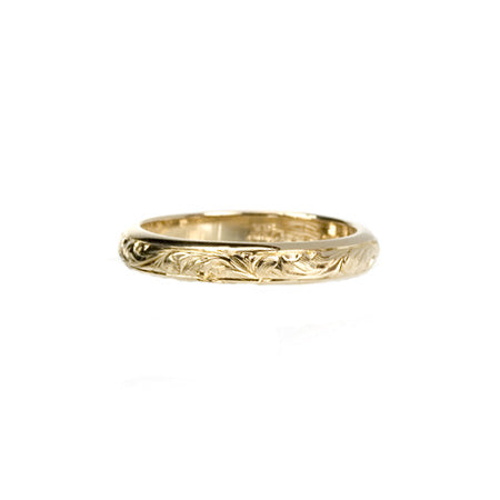 Crafted in 14KT yellow gold, this band has paisley hand-engraving.