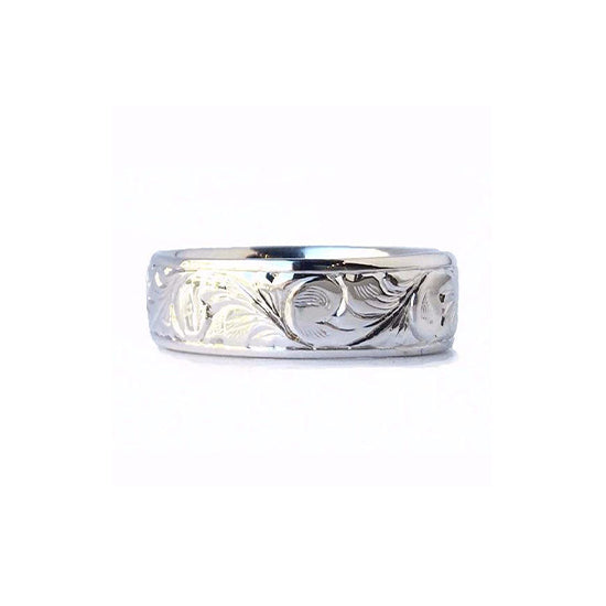Crafted in 14KT white gold, this 7.5mm men's ring features stunning paisley hand-engravings all around the band.
