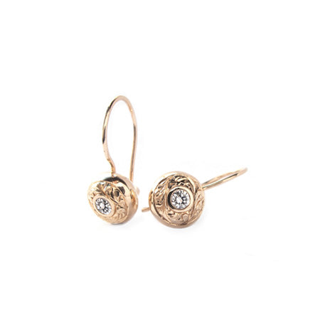 Crafted in 14KT rose gold, these drop earrings feature round brilliant-cut diamonds with paisley hand-engraved halos.