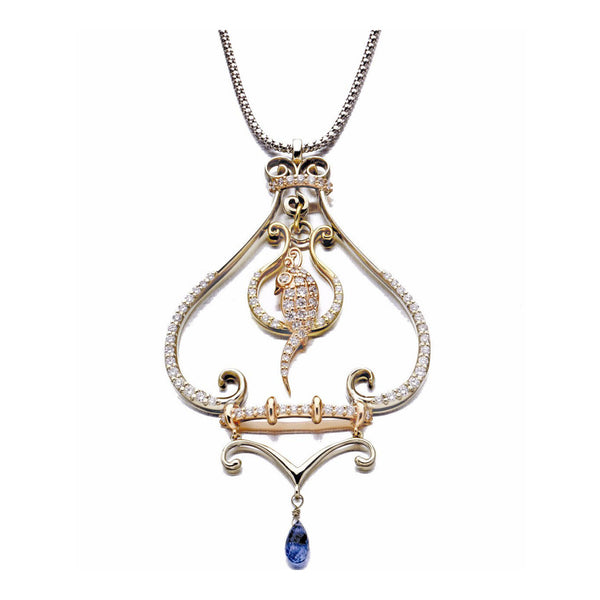 Crafted in 14KT yellow, white and rose gold, this necklace features a bird atop a delicate curled perch, both set with round brilliant-cut diamonds. A blue sapphire briolette hangs below, adding a regal touch of colour to this piece.