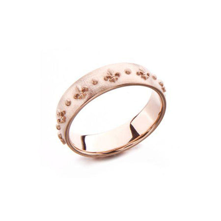 Crafted in 14KT rose gold, this ring is embossed with Fleur de Lys all around the band.