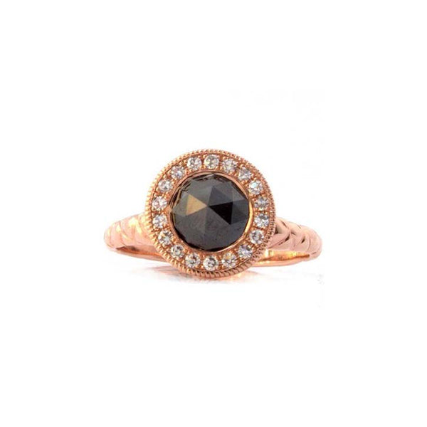 Crafted in 14KT rose gold, this ring features a diamond halo with a black rose-cut diamond centre and a quilted band.