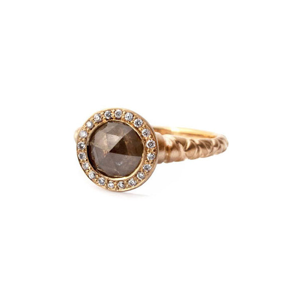Crafted in 14KT rose gold, this ring features a diamond halo with a brown rose-cut diamond centre and a quilted band.