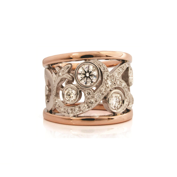 Crafted in 14KT white and rose gold, this ring features a diamond-set rose vine design.