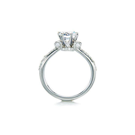 Crafted in 14KT white gold, this ring features a round brilliant-cut centre diamond on a diamond-set band.