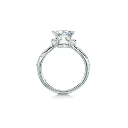 Crafted in 14KT white gold, this ring features a princess-cut centre diamond on a diamond-set band.