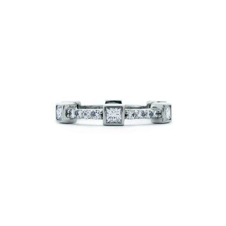 Crafted in 14KT white gold, this ring features six princess-cut diamonds evenly spaced apart on a diamond set band.