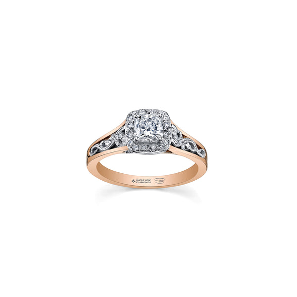 Filigree engagement ring crafted from 18kt rose Canadian Certified Gold and 18kt Pure White™, features a diamond-set halo surrounding a 0.70CT cushion-cut Canadian diamond centre with 0.80CTW.