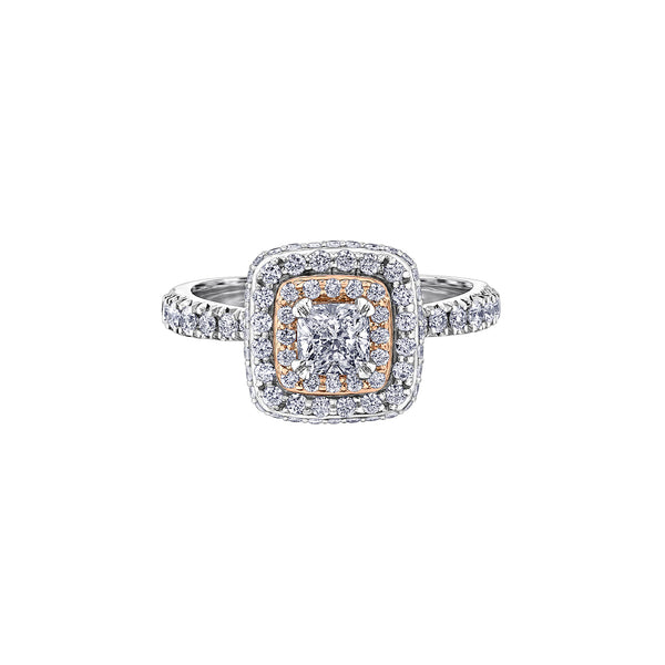 Crafted in 18KT rose and white Certified Canadian Gold, this ring features a diamond set double halo with a cushion-cut Canadian centre diamond. Diamond set band and has hidden maple leaf details.