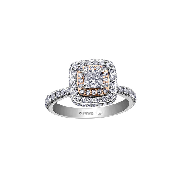 Stunning ring features a 0.50CT cushion cut Canadian Certified Diamond surrounded by a rose gold diamond halo and a white gold diamond halo.