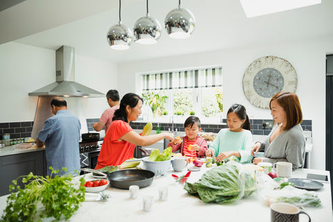 Family cooking in new kitchen